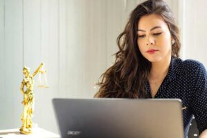 Female lawyer participating in a virtual consultation after transitioning to remote legal workforce