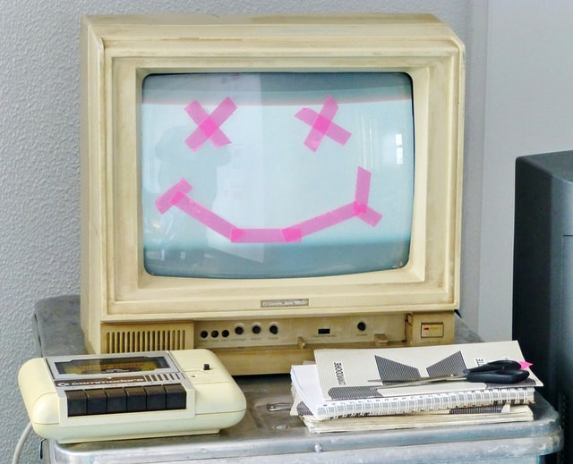 Replace this old Commodore 1802 computer with a smiley face with X's for eyes on the screen made with pink tape as part of your Summer school IT projects