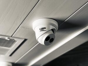 CDS-branded turret security camera installed on ceiling as part of network infrastructure expansion